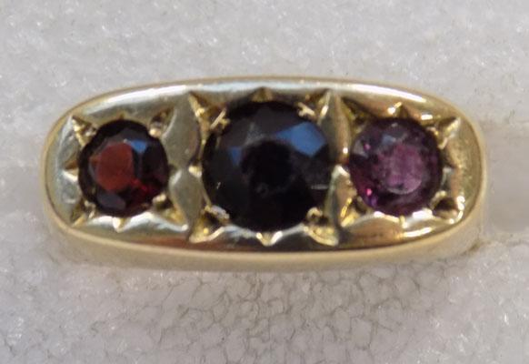Old 9ct gold garnet trilogy ring gypsy setting