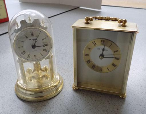 One carriage clock and small mantle clock