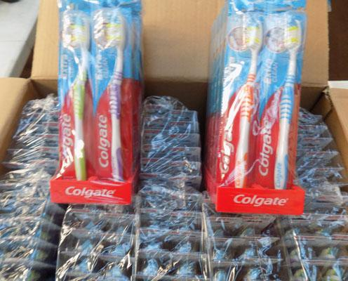 Box of Colgate extra clean medium toothbrushes