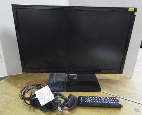 Samsung TV  with remote and leads in office