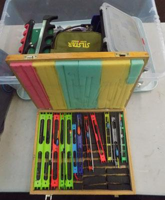 Box of pole rigs and accessories
