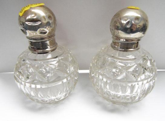 2 silver top cut glass perfume bottles