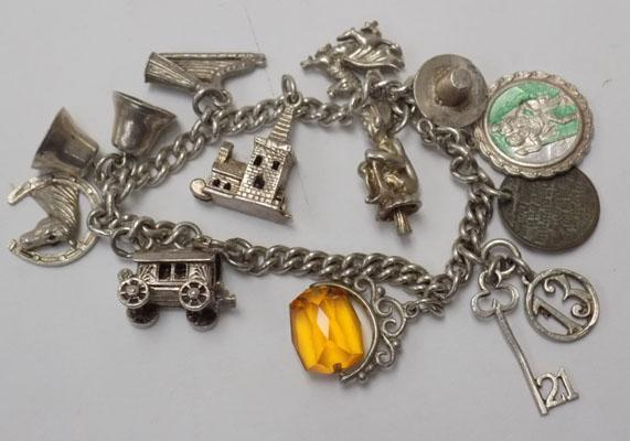 Silver charm bracelet with charms