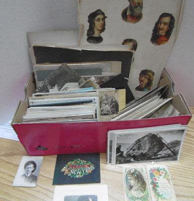 Box of postcards and photos