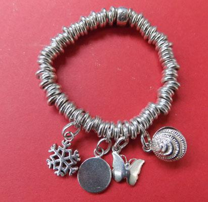 Links of London 925 bracelet with charms