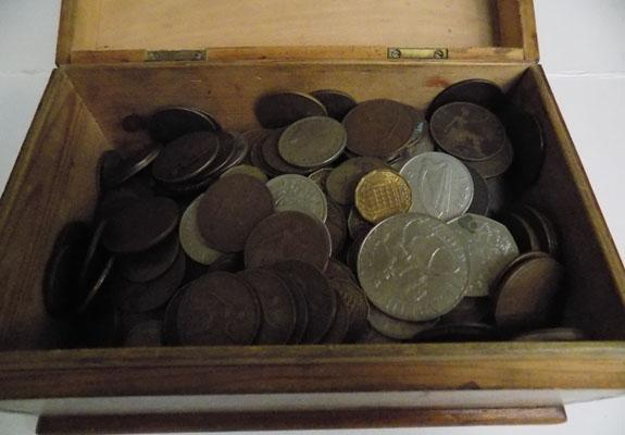 Wooden box full of coins