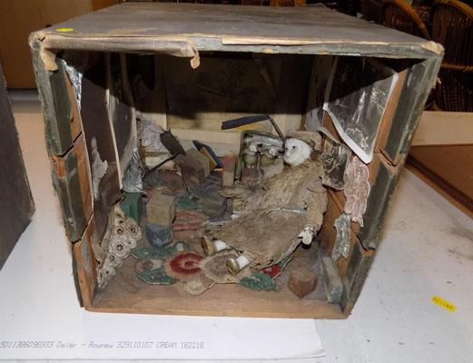 Porcelain doll in  display theatre box