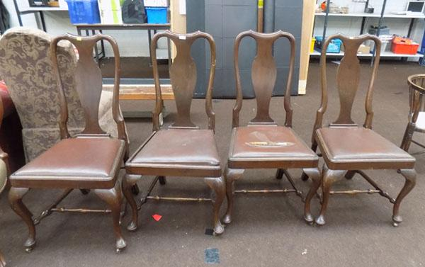 Four large dining chairs