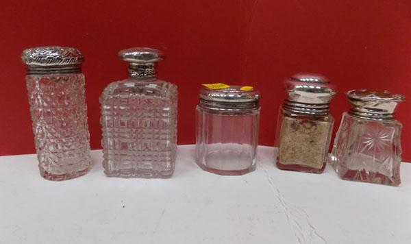 5 Assorted silver topped bottles