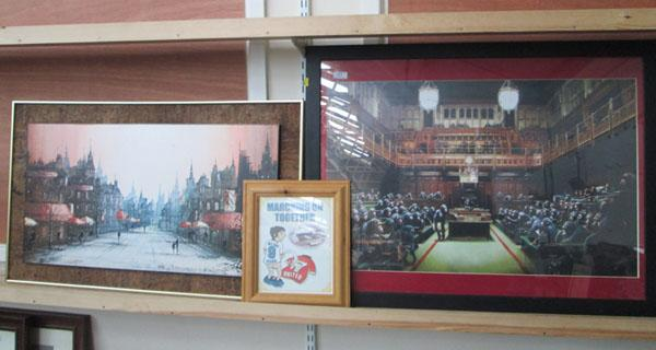 Comical house of commons, a monkey picture and a city print