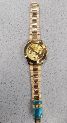 Gold coloured mens watch