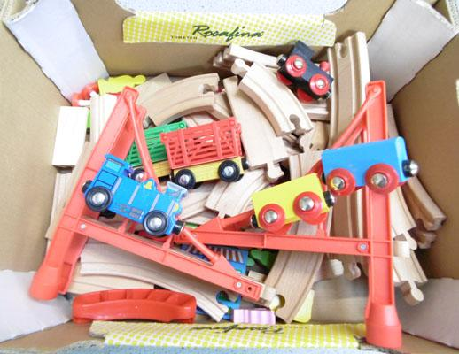 Box of wooden trains and track