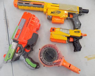 Box of 3 Nerf guns and accessories