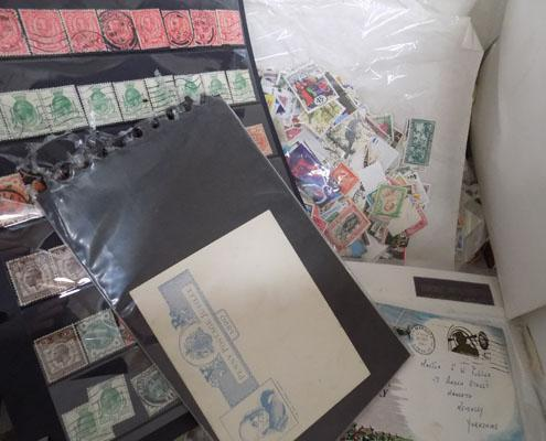 Large box of stamps in packets