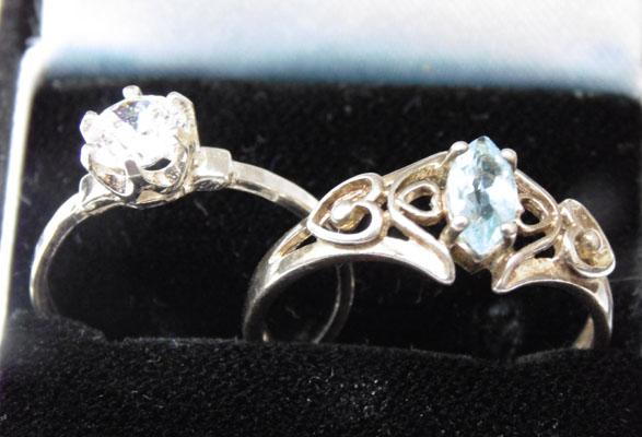 2x Silver rings, white stone solitaire & ornate blue Topaz
