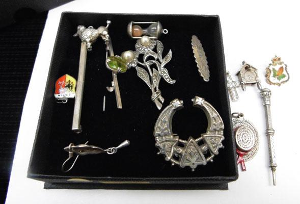 Collection of silver items, brooches, charms etc