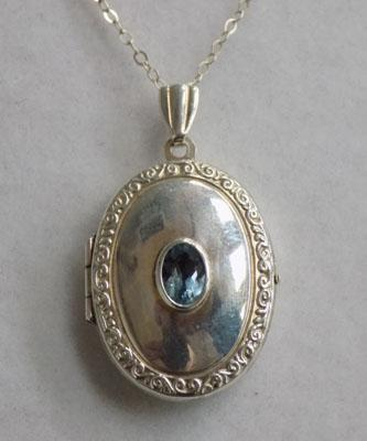 Sterling silver locket necklace with Blue Topaz stone