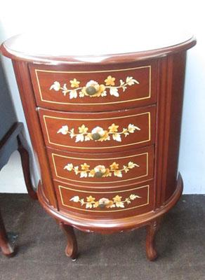 Oval inlaid chest of drawers