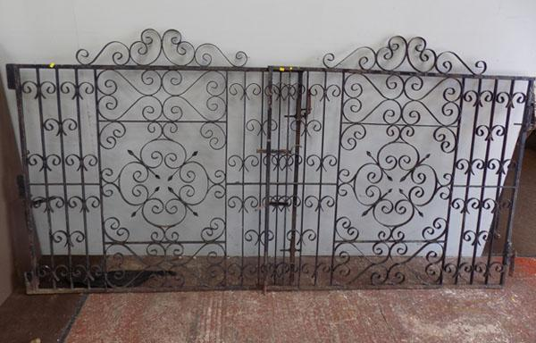 "Pair of metal gates (approx 57""wx49"" each)"