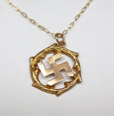 9ct Gold chain & Swastika style pendant