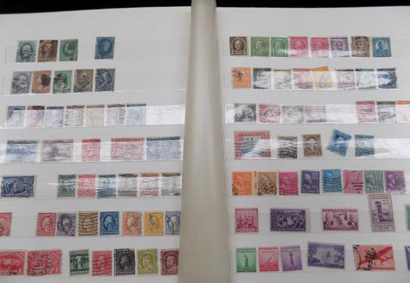 Large stock book of 19th Century stamps etc