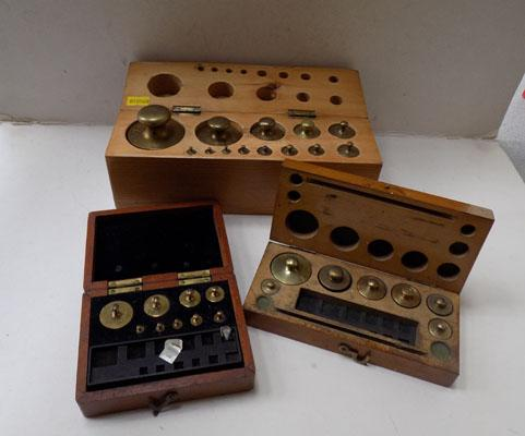 Three sets of measuring weights in wooden cases