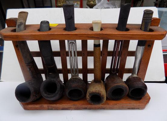 Collection of old Pipes on pipe rack