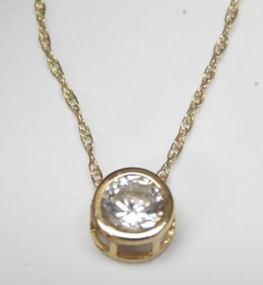 9ct Gold solitaire pendant on gold chain