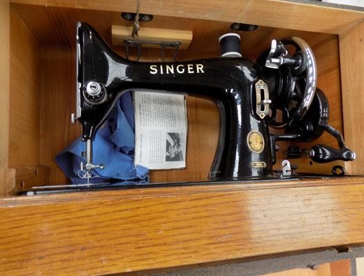 Singer sewing machine in box with portable table