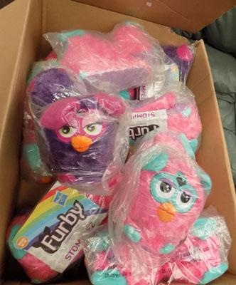 Box of Furby slippers