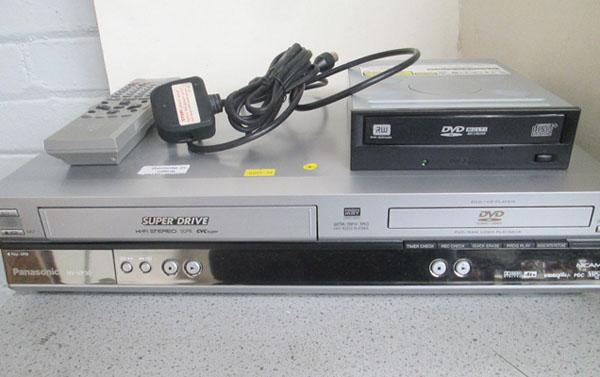VHS/DVD player w/o & PC DVD/CD recorder (remote in office)