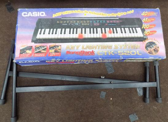 Casio keyboard & stand in box