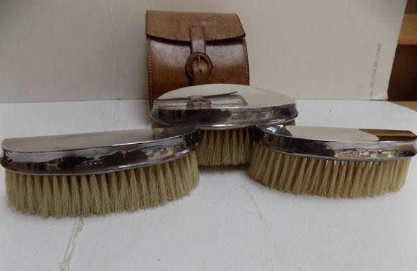 Silver brush set in leather case
