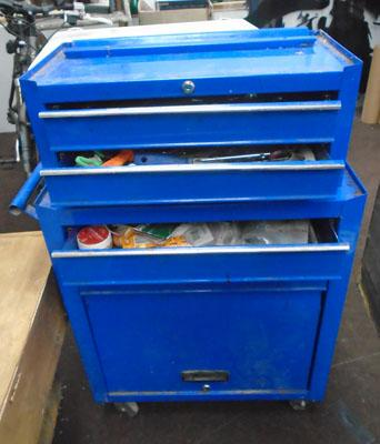 Large metal cabinet on wheels with tools