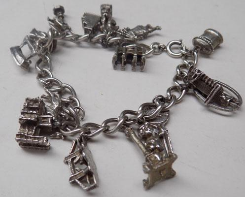 925 Silver charm bracelet with 17 assorted charms