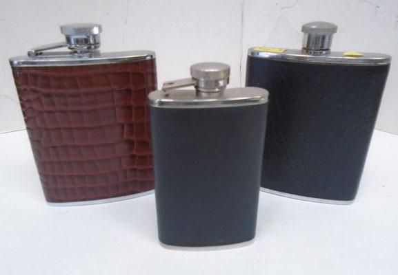 Trio of leather cased hip flasks