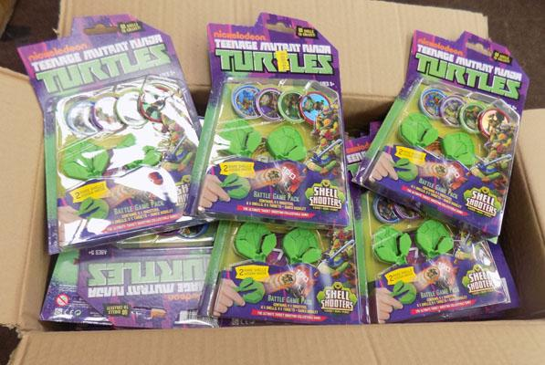 Box of approx 66 Turtles shell shooters