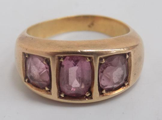 Pink stone, yellow metal ring
