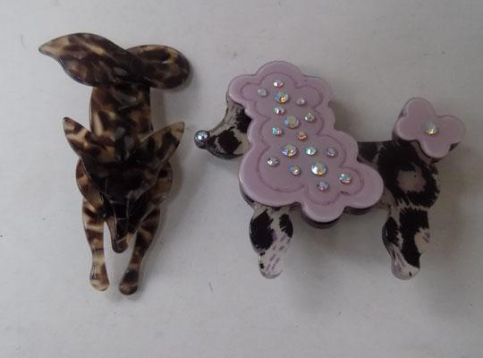 Pair of Lea Stein style brooches