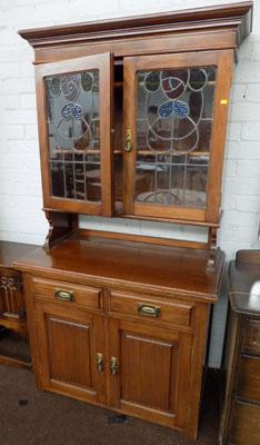 Oak display cabinet with stained glass front