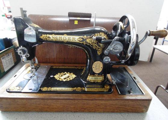 Singer sewing machine & key in office