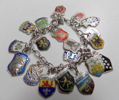 Silver charm bracelet with shield charms