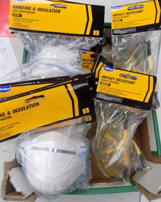Box of new safety glasses and dust masks