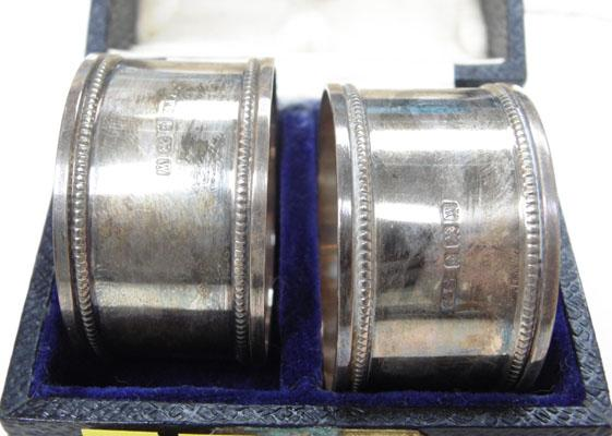 Pair of sterling silver napkin rings in box