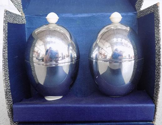 Pair of 1930's egg warmers, Heat Master in original box