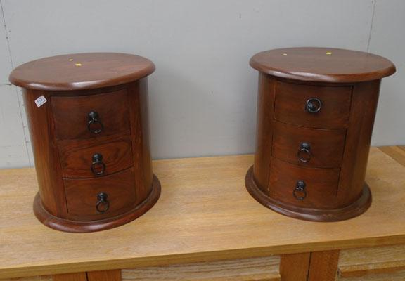 Pair of round bedside tables
