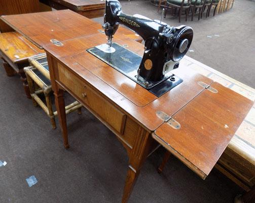 Singer sewing machine on wood stand/cabinet