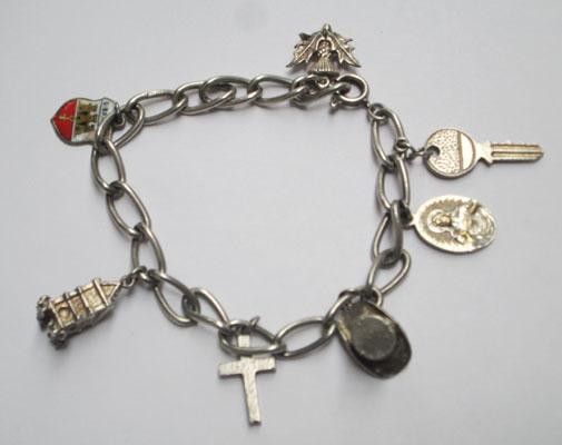 Silver charm bracelet with charms-some vintage