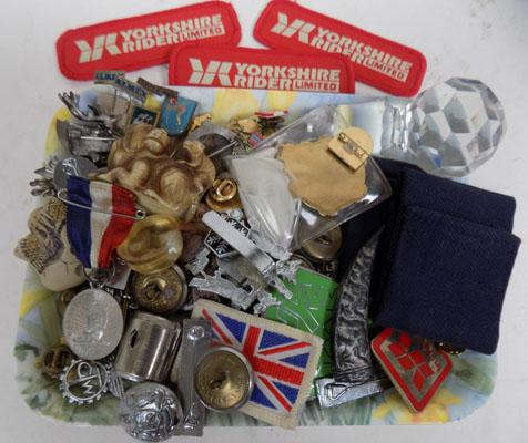 Tub of mixed badges