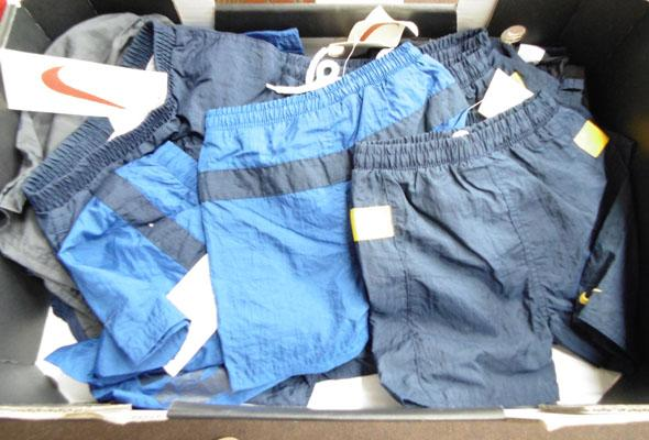 Box of new children's Nike shorts approx 31 pairs